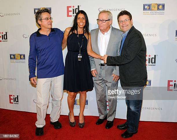 Writer Angelo Pizzo Rudy Foundation founder Cheryl Ruettiger music editor Kenneth Hall and actor Sean Astin arrive at the 20th anniversary...