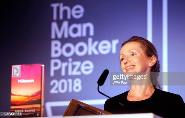 Writer Anna Burns smiles after she was presented with the Man Booker Prize for Fiction 2018 by Camilla Duchess of Cornwall during the prize's 50th...