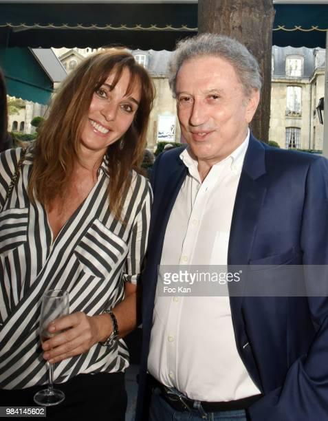 Writer Anna Veronique El Baze and Michel Drucker attend 'L'Ete Litteraire Des Deux Magots ' Book Signing Cocktail at Les Deux Magots Cafe on June 25...