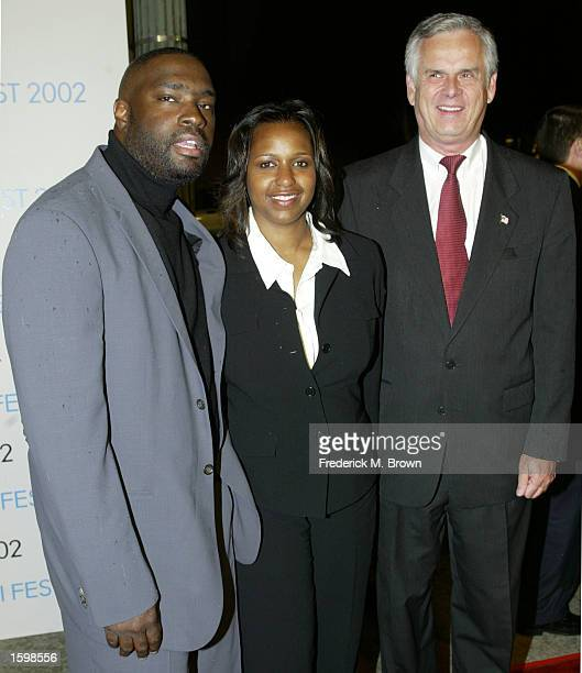 Writer Antwone Fisher his wife LaNette and Los Angeles major James Hahn attend the film premiere of Antwone Fisher during the opening night gala of...