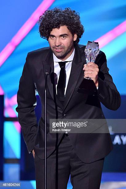 Writer Armando Bo accepts the Best Original Screenplay award for 'Birdman' onstage during the 20th annual Critics' Choice Movie Awards at the...