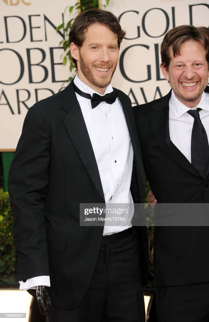 Writer Aron Ralston (L) and Producer Christian Colson arrive at the 68th Annual Golden Globe Awards held at The Beverly Hilton hotel on January 16, 2011 in Beverly Hills, California.