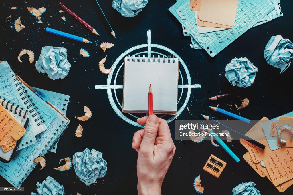 Writer at work: deciding on goal : Stock Photo