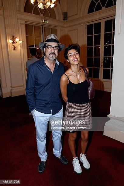 Writer Atiq Rahimi and his daughter Alice attend the 'Momo' Theater Play At Theatre de Paris on August 31 2015 in Paris France