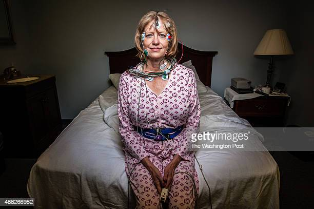 Writer Barbara Moffet reenacts her sleep lab preparation for a photographer Moffet wrote about her experience in a sleep lab for the Post