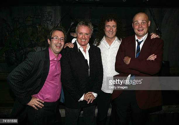 Writer Ben Elton, Queen's Roger Taylor and Brian May and comedian Al Murray pose backstage at the Dominion Theatre as Queen and Ben Elton's We Will...