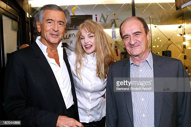 Writer BernardHenri Levy director of the movie Arielle Dombasle and Pierre Lescure attend 'Opium' movie Premiere held at Cinema Saint Germain in...