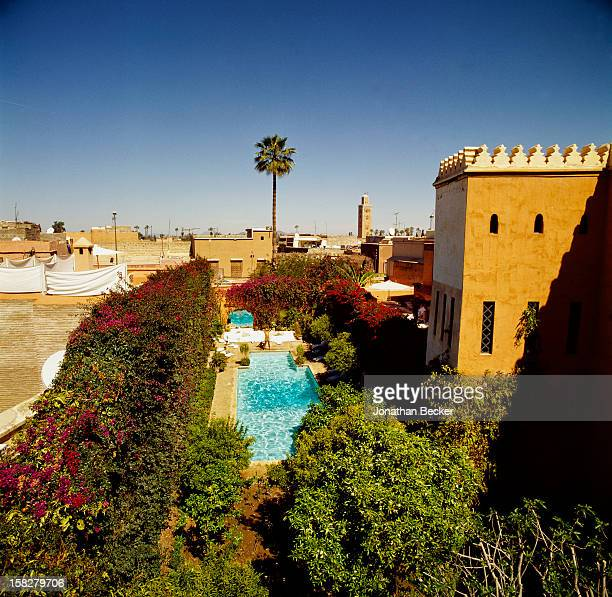 Writer BernardHenri Levy is photographed for Vanity Fair Magazine on March 16 2002 at the pool in his eighteenth century palace in Marrakech Morocco...