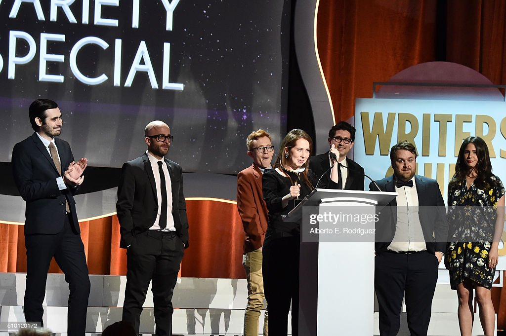 Writer Bess Kalb (speaking at lectern) and fellow writers accept the Comedy/Variety Specials award for 'Jimmy Kimmel Live: 10th Annual After The Oscars Special' onstage during the 2016 Writers Guild Awards at the Hyatt Regency Century Plaza on February 13, 2016 in Los Angeles, California.
