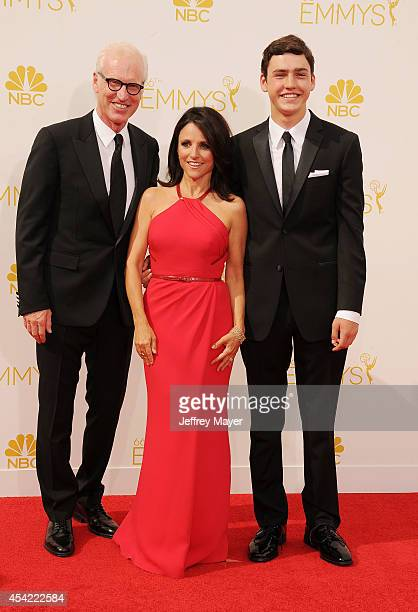 Writer Brad Hall actress Julia LouisDreyfus and Charles Hall arrive at the 66th Annual Primetime Emmy Awards at Nokia Theatre LA Live on August 25...