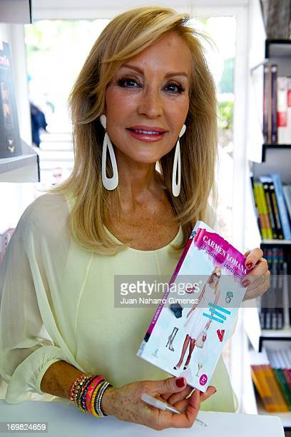 Writer Carmen Lomana attends a book signing during 'Books Fair 2013' at the Retiro Park on June 2 2013 in Madrid Spain