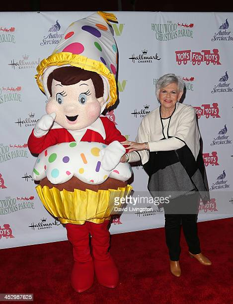 Writer Carol Aebersold poses with 'Elf on a Shelf' character at the Hollywood Christmas Parade benefiting the Toys for Tots Foundation on December 1...