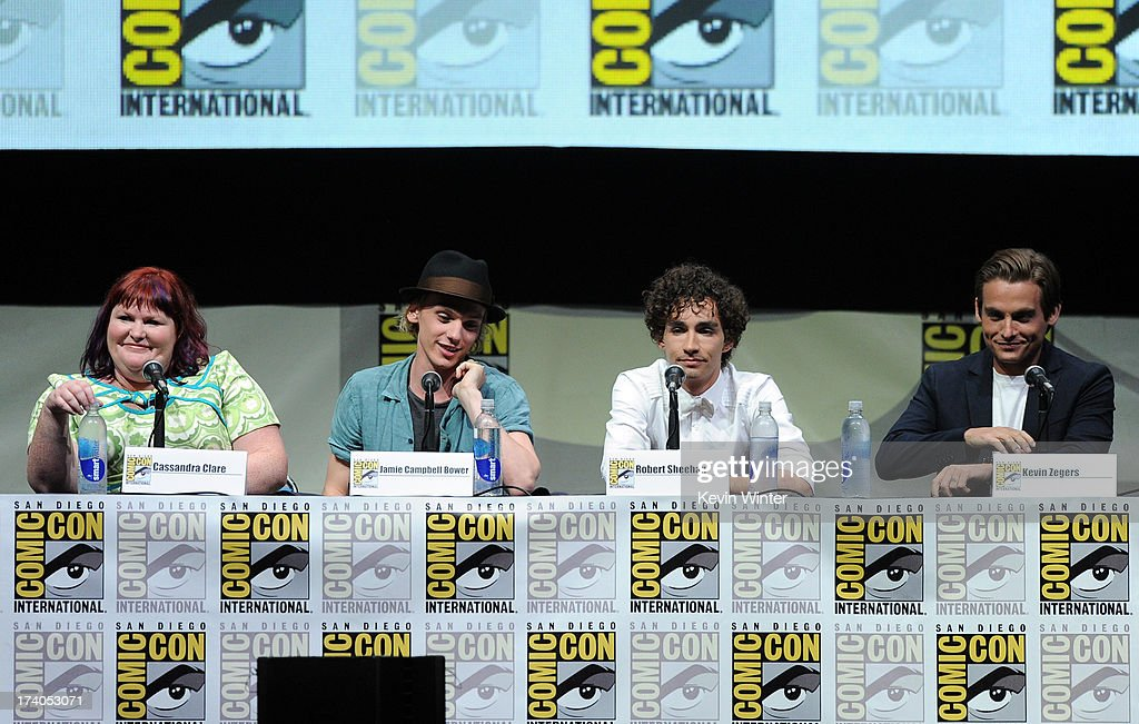Writer Cassandra Clare, actors Jamie Campbell Bower, Robert Sheehan, and Kevin Zegers speak onstage at the Sony and Screen Gems panel for 'The Mortal Instruments: City of Bones' during Comic-Con International 2013 at San Diego Convention Center on July 19, 2013 in San Diego, California.