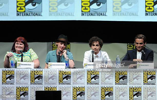 Writer Cassandra Clare actors Jamie Campbell Bower Robert Sheehan and Kevin Zegers speak onstage at the Sony and Screen Gems panel for 'The Mortal...