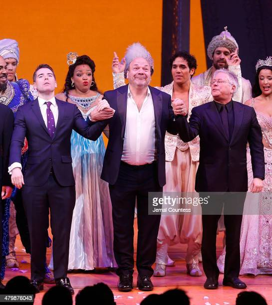 Writer Chad Beguelin director Casey Nicholaw and composer Alan Menken join the the cast of Aladdin on stage to take a bow during curtain call at the...