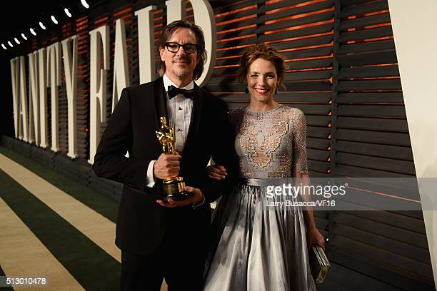 Writer Charles Randolph and actress Mili Avital attend the 2016 Vanity Fair Oscar Party Hosted By Graydon Carter at the Wallis Annenberg Center for...