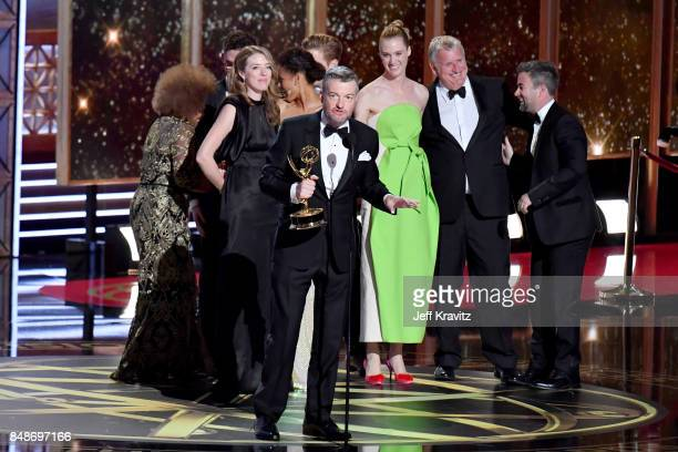 Writer Charlie Brooker with the cast and crew of 'Black MirrorSan Junipero' accept an award onstage during the 69th Annual Primetime Emmy Awards at...