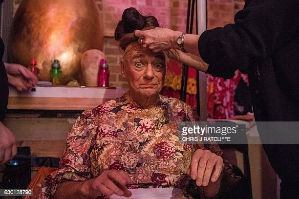 Writer comedian and actor Roy Hudd who plays the character 'Mother Goose' is pictured in the midst of a costume change during a performance of the...