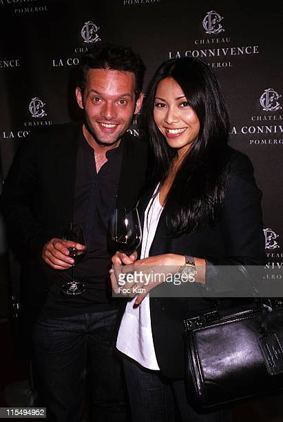 Writer Cyril Montana and singer Anggun attend the Chateau Connivence 2008 Pomerol Wine Launch Cocktail at the Terrasse M6 on June 11 2009 in Paris...