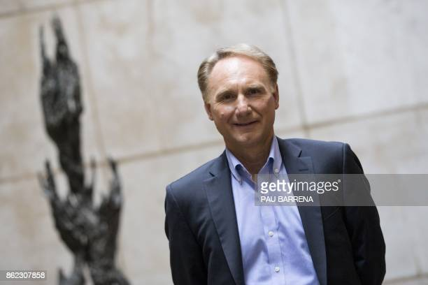 """Writer Dan Brown poses during the presentation of his new book """"Origin"""" at Casa Mila, known as La Pedrera, in Barcelona on October 17, 2017."""