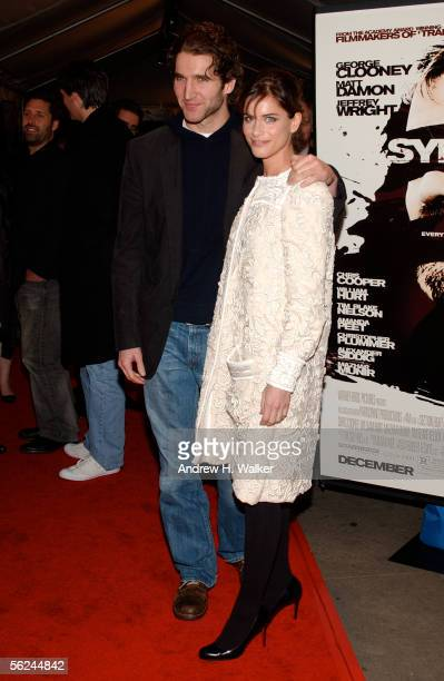 Writer David Benioff and fiancee actress Amanda Peet attend the premiere of 'Syriana' at the Loews Lincoln Center theatre on November 20 2005 in New...