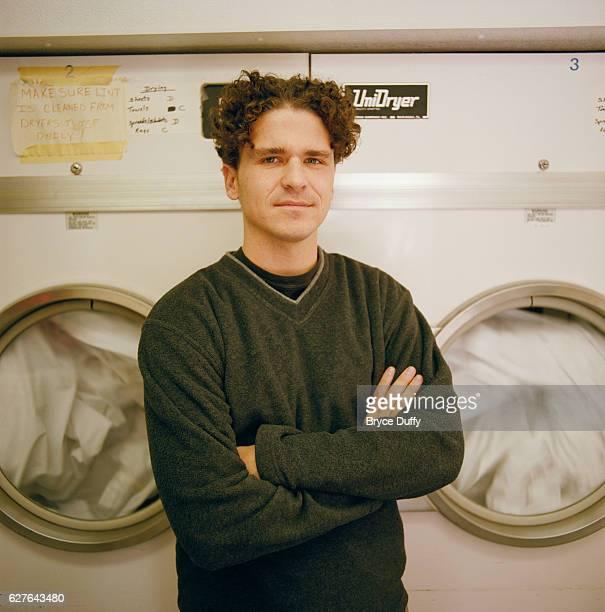 Writer David Eggers Standing in Laundromat
