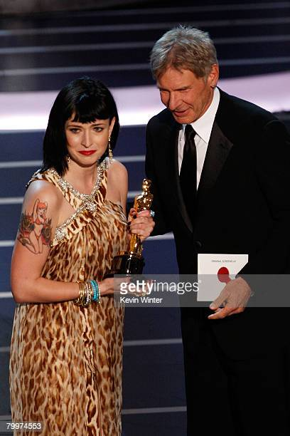 TELECAST*** Writer Diablo Cody stands with Harrison Ford after winning the award for Best Original Screenplay for the movie Juno during the 80th...