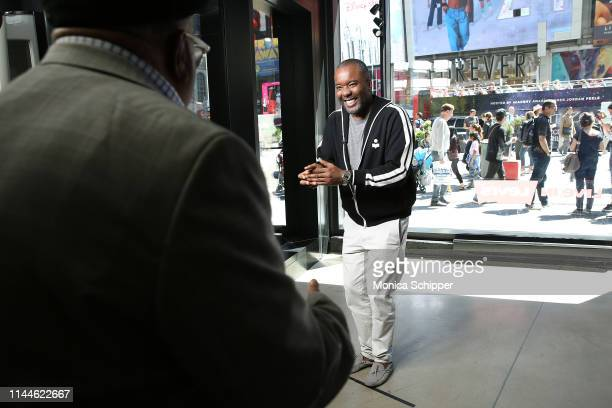 """Writer director and producer Lee Daniels greets Charles Allen son of Eugene Allen whom his film """"The Butler"""" was based upon when he visits 'Extra' at..."""