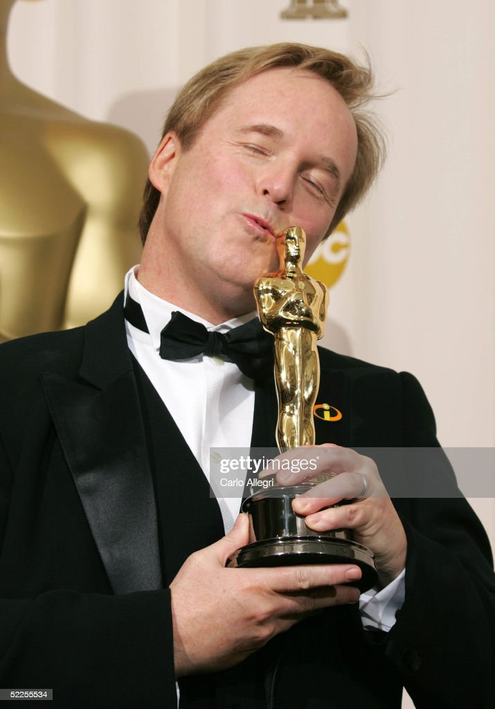 Writer Director Brad Bird poses with his 'Best Animated Feature Film' for 'The Incredibles' backstage during the 77th Annual Academy Awards on February 27, 2005 at the Kodak Theater in Hollywood, California.