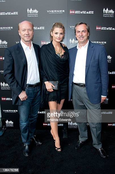 Writer / director Paul Haggis actress Stana Katic and Vhernier Jewels President Carlo Traglio arrive at the Artists for Peace and Justice A Ring to...