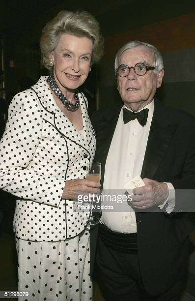 Writer Dominick Dunne and Dina Merrill at the surprise 80th birthday party for legendary musician Bobby Short, September 12, 2004 at the Rainbow Room...