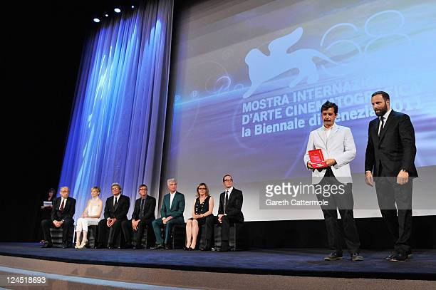 Writer Efthymis Filippou and filmmaker Yorgos Lanthimos of Alps accept the Best Screenplay Award during the Closing Ceremony during the 68th Venice...