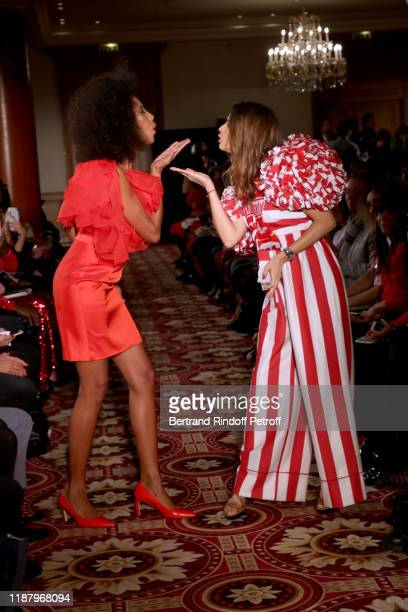 Writer Elizabeth Tchoungui and Journalist Margaux de Frouville walks the runway during the 3rd Sauvez Le Coeur Des Femmes Red Defile show at Hotel...