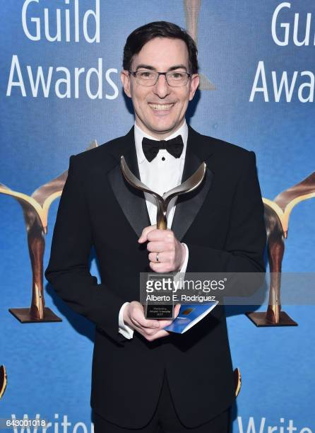 Writer Eric Heisserer poses with the Adapted Screenplay Award for 'Arrival during the 2017 Writers Guild Awards LA Ceremony at The Beverly Hilton...
