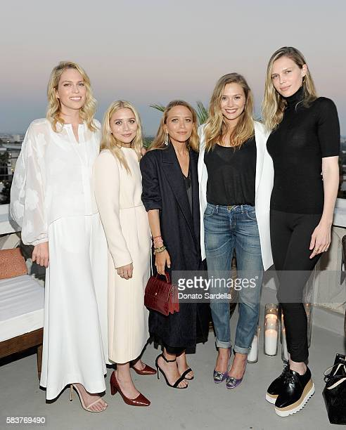 Writer Erin Foster designers Ashley Olsen and MaryKate Olsen actresses Elizabeth Olsen and Sara Foster attend Elizabeth and James Flagship Store...