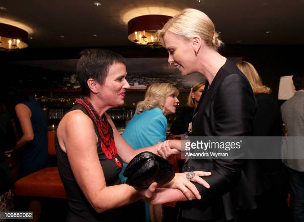 Writer Eve Ensler and actress Charlize Theron attend Eve Ensler and V-Day celebrate the opening of City of Joy in the DRC held at Soho House on...