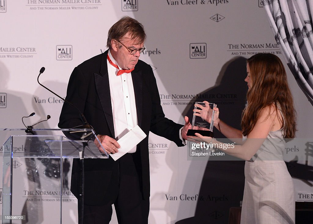 Writer Garrison Keillor (L) speaks onstage during the Norman Mailer Center 4th Annual Benefit Gala on October 4, 2012 in New York City.