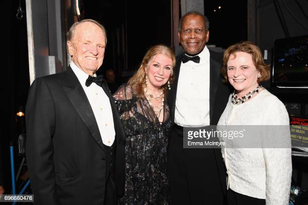 Writer George Stevens Jr., Joanna Shimkus, actor Sidney Poitier, and _____ backstage during American Film Institute's 45th Life Achievement Award...
