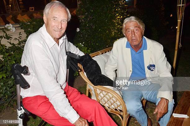 Writer Gerard De Villiers and auctioneer Maitre Pierre Cornette de Saint Cyr attend the Massimo Gargia Summer Party at Les Moulins de Ramatuelle on...