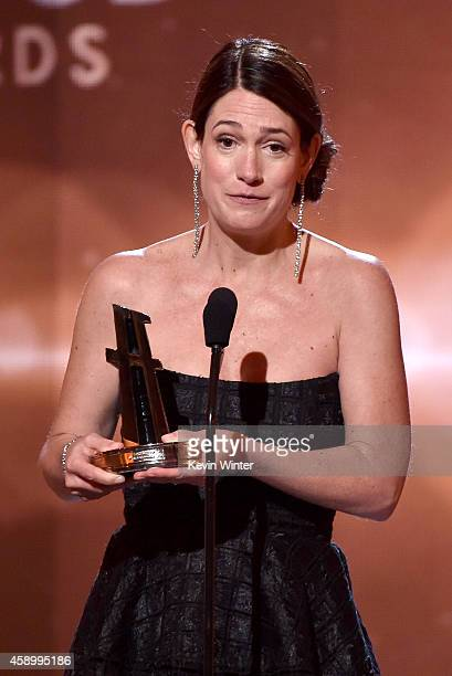 Writer Gillian Flynn accepts the Hollywood Screenwriter Award for 'Gone Girl' onstage during the 18th Annual Hollywood Film Awards at The Palladium...