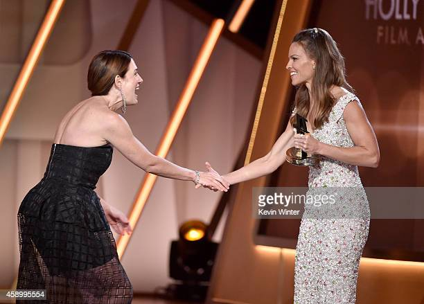 Writer Gillian Flynn accepts the Hollywood Screenwriter Award for 'Gone Girl' from actress Hilary Swank onstage during the 18th Annual Hollywood Film...
