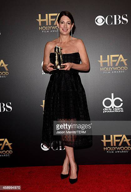 Writer Gillian Flynn winner of Hollywood Screenwriter for 'Gone Girl' poses in the press room during the 18th Annual Hollywood Film Awards at The...