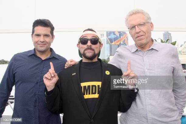 Writer Graham Roland host Kevin Smith and writer Carlton Cuse attend the #IMDboat At San Diego ComicCon 2018 Day Two at The IMDb Yacht on July 20...
