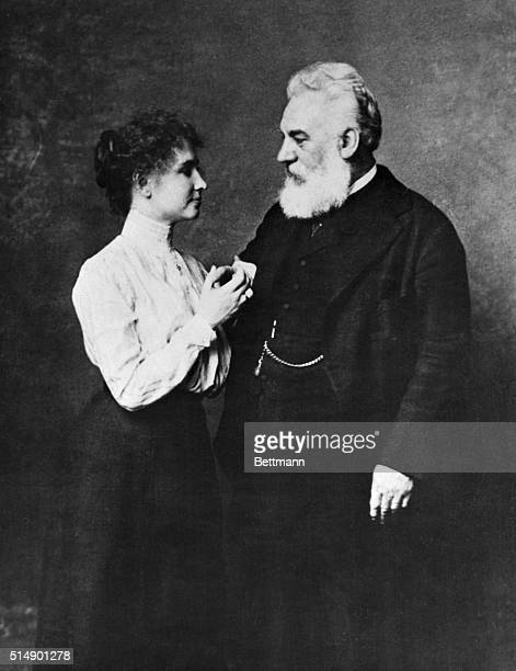 Writer Helen Keller and inventor of the telephone Alexander Graham Bell using the manual alphabet of the deaf and blind. Bell did extensive research...