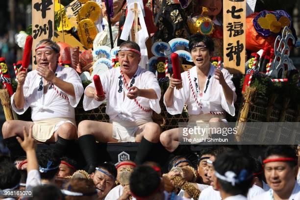 Writer Hitonari Tsuji joins a Hikiyama float of the Nakasu Nagare team during the 'Shudan Kaomise' event as a part of the Hakata Gion Yamakasa on...