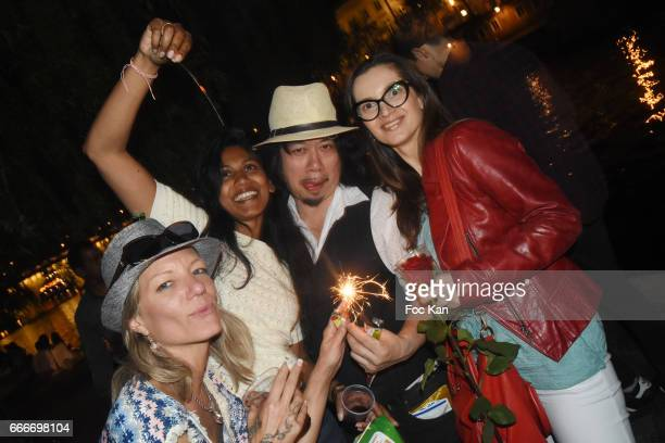 Writer Igor Bogdanov model Julie Jardon and designer Georges Bedran attend Photographer Ko Kok Birthday Party At Le Vert Galant Garden on April 9...