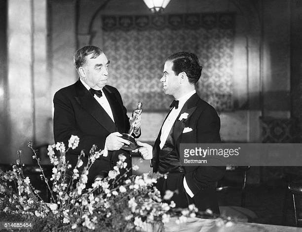 Writer Irvin S Cobb presents Frank Capra with the Best Director Oscar for his work on It Happened One Night The stars of the film Claudette Colbert...