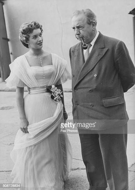 Writer J B Priestley author of the play 'An Inspector Calls' talking to actress Eileen Moore during a visit to the set of the the film adaptation of...