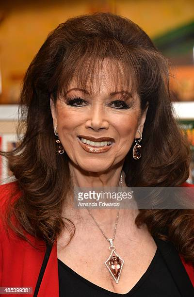 Writer Jackie Collins poses before signing copies of her new book The Lucky Santangelo Cookbook at Barnes Noble bookstore at The Grove on April 17...