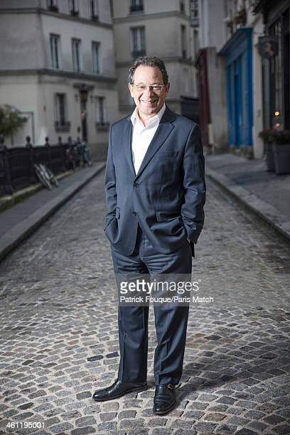 Writer Jacques Baudouin is photographed for Paris Match on December 18, 2013 in Paris, France.